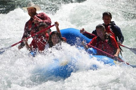 Blue-sky-rafting-estacada-clackamas-group-hits-a-big-rapid-on-a-river-in-Oregon2