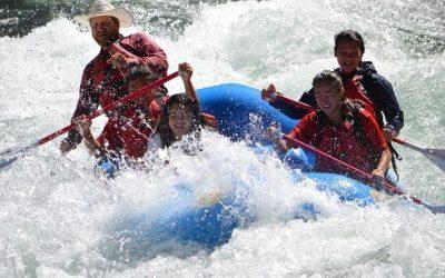 Blue-sky-rafting-estacada-clackamas-group-hits-a-big-rapid-on-a-river-in-Oregon2